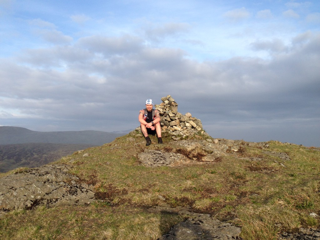 Aaron takes a break on the Slievemoughanmore summit cairn!